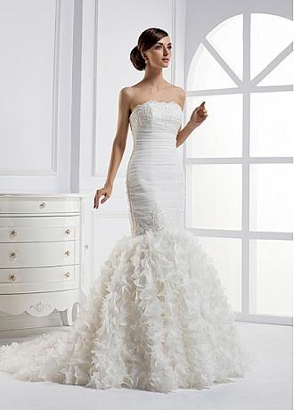 A wedding dress with ruffle bottom with flowers Wedding dress gallery